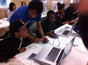Kids learning how to control motors using Arduino.